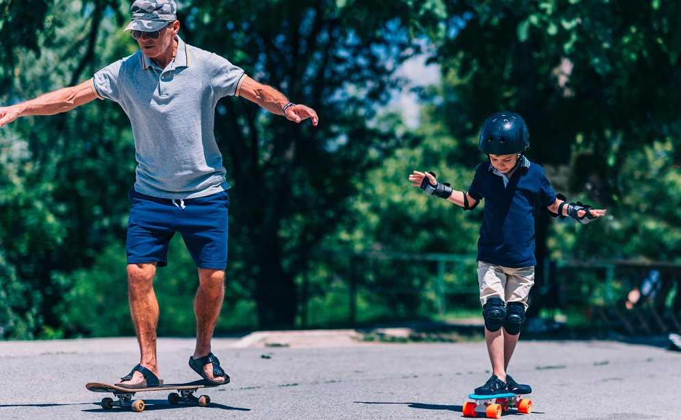 Grandfather teaching grandson to skateboard The Tonic www.thetonic.co.uk