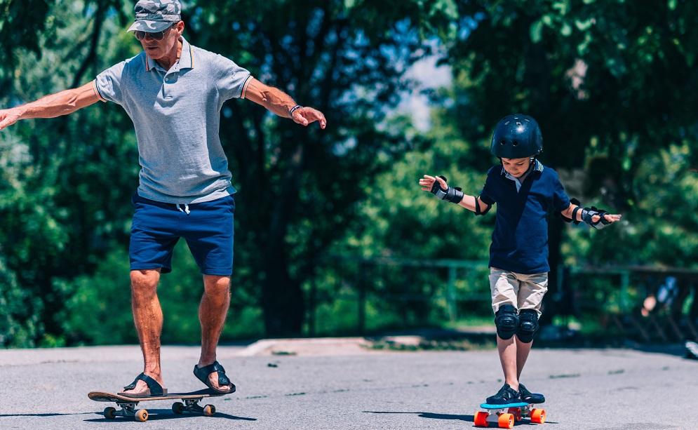 Grandfather teaching grandson to skateboard The Tonic www.thetonic.co.uk